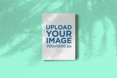 Mockup of a Magazine Under the Shade of a Palm Tree 2460-el1