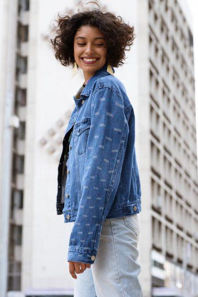 Sleeve Mockup Featuring a Joyful Woman Wearing a Denim Jacket in the City 32575