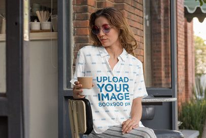 Button-Up Shirt Mockup Featuring a Woman Sitting Outside a Cafe 33134