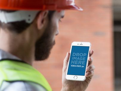 Mockup of a Construction Man Using His iPhone in Portrait Mode 12418