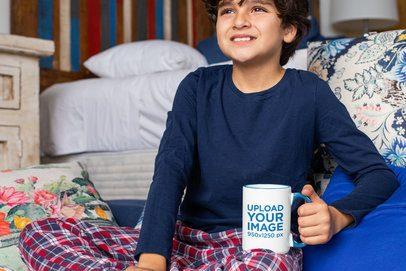 Mockup of a Boy Holding a 15 oz Colored Rim Mug at Home 33170