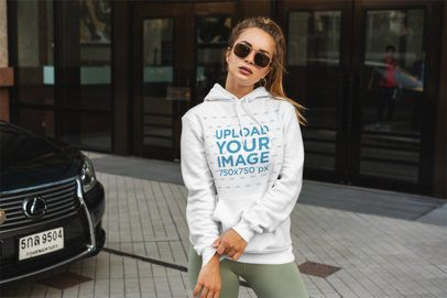 Hoodie Mockup Featuring a Fashionable Woman Posing on the Street 3559-el1