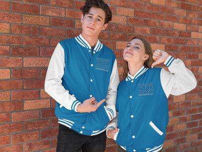 Mockup of a Man and a Woman Wearing Varsity Jackets 33214