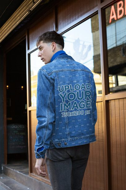 Back View Mockup of a Serious Man Wearing a Sublimated Denim Jacket 32612