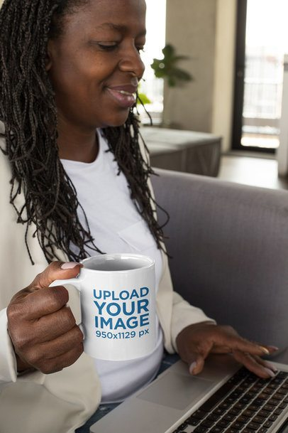 11 oz Mug Mockup Featuring a Middle-Aged Woman Drinking Coffee While Working 32903