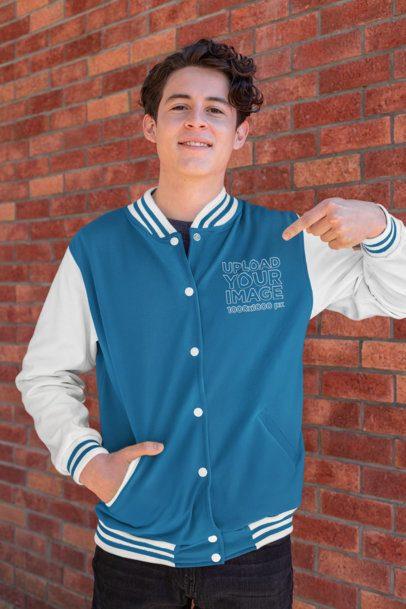 Mockup of a Young Man Pointing at His Varsity Jacket 33213