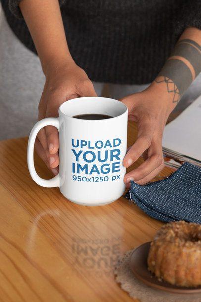 Mockup of a Tattooed Woman Holding a 15 oz Mug 33178