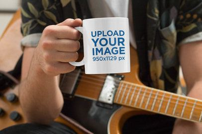 Mockup of a Musician Holding an 11 oz Coffee Mug 33324