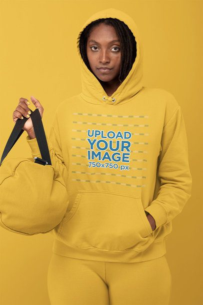 Hoodie Mockup Featuring a Woman in a Monochromatic Outfit at a Studio 32809