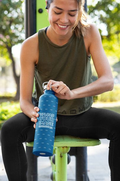 Mockup of a Young Woman Holding an Aluminum Bottle 33520