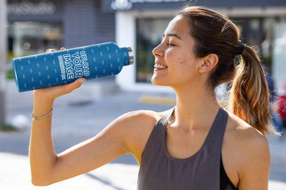 Mockup of a Fit Woman Drinking from an Aluminum Bottle 33514