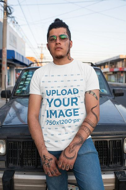 T-Shirt Mockup of a Tattooed Man Posing on the Street 32820