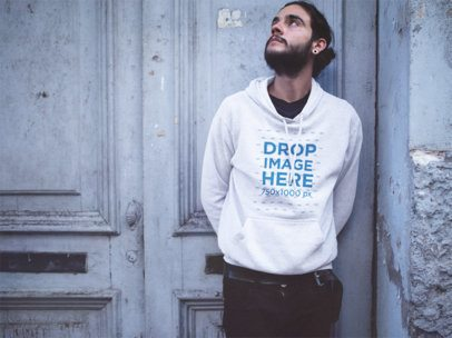 Pullover Hoodie Mockup of a Guy with Long Hair Leaning Against a Door a12591