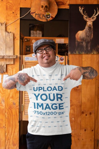 Mockup of a Man Pointing at His T-Shirt at a Rustic Bar 32854