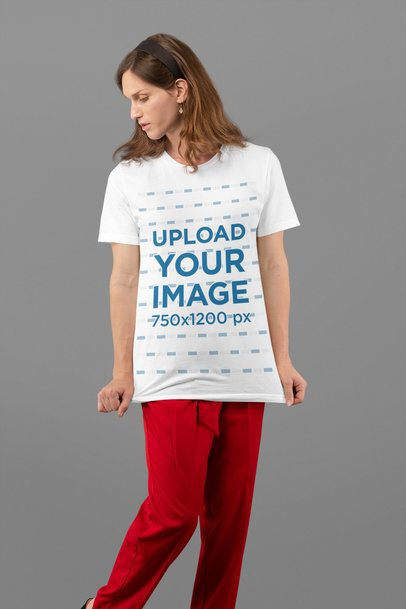 Studio Mockup of a Woman Grabbing Her T-Shirt 32941
