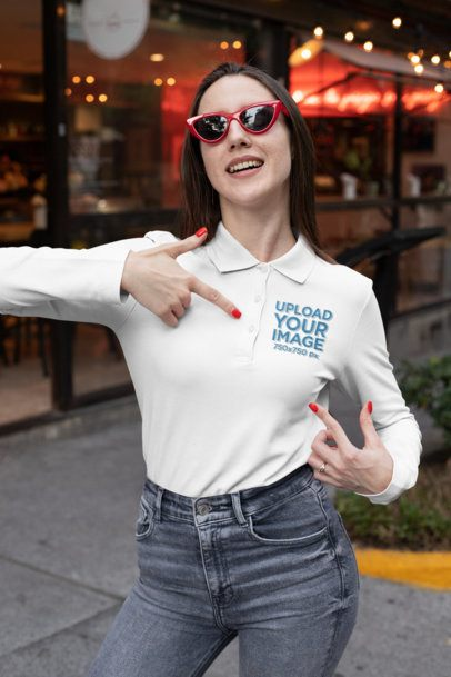 Mockup of a Woman Pointing at the Design on Her Long Sleeve Polo Shirt 33466