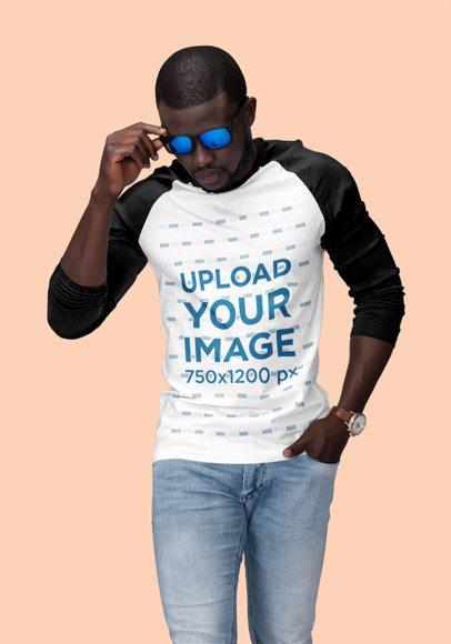 Studio Mockup of a Cool Man Posing with a Three-Quarter Sleeve Raglan T-Shirt 1810-el1