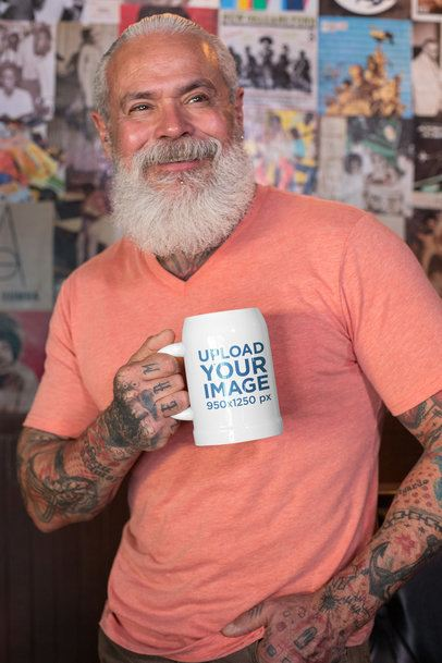 Mockup of a Tattooed Senior Man Holding a Beer Stein 33435