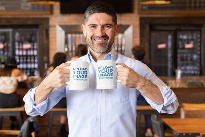 Mockup of a Man Holding Two Beer Mugs at a Bar 33440