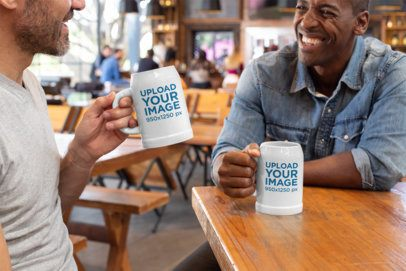Mockup of Two Friends Holding 20 oz Beer Steins 33427