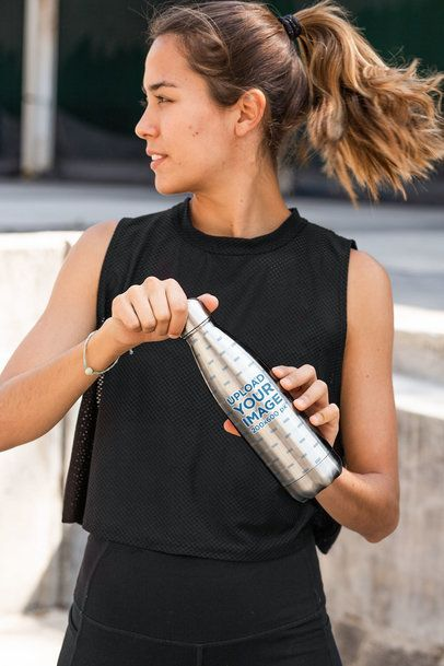 Aluminum Bottle Mockup Featuring a Woman with a Ponytail 33501