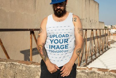 Tank Top Mockup of a Tattooed Man Standing in the Sunlight 32846