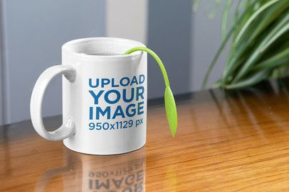 Mockup of a Mug with Steam and a Tea Infuser 33662