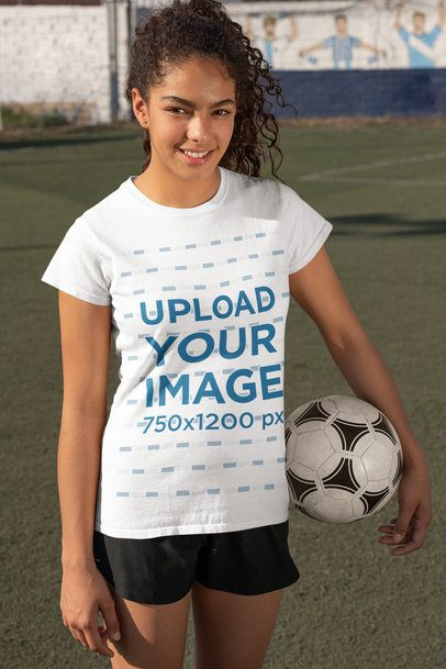 T-Shirt Mockup Featuring a Female Soccer Player Holding a Ball 33577