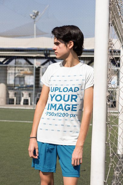 Jersey Mockup of a Soccer Player Leaning Against a Goal Post 33557