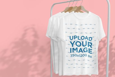 Mockup of a Hanging T-Shirt Featuring Tree Shadows in the Background 3724-el1