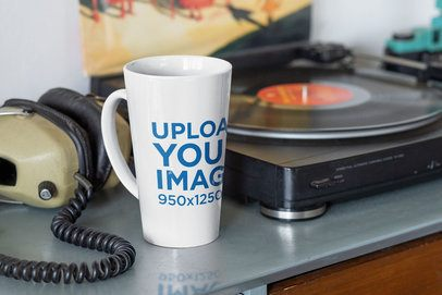 Mockup of a 15 oz Coffee Mug Next to a Record Player 33661