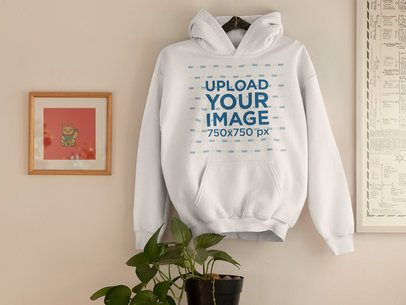 Mockup of a Hoodie as a Decorative Piece on a Wall 33765