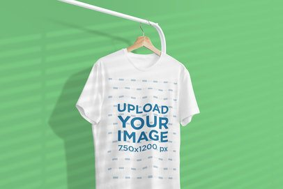 Mockup of a One Tee Hanging From a Clothing Rack Featuring a Background Shadow 3734-el1