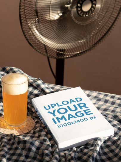 Mockup of a Book Lying Next to a Glass of Beer 33911