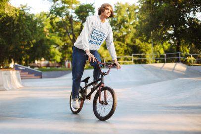 Sweatshirt Mockup of a Young Man Using an Acrobatic Bicycle 34013-r-el2