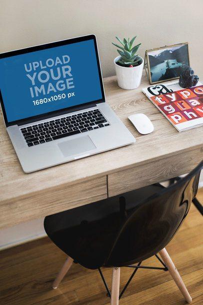 MacBook Mockup Featuring a Comfortable Home Office 3809-el1