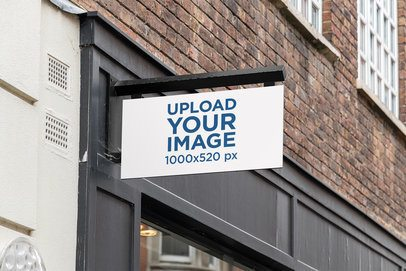 Mockup of an Outdoor Sign Placed on a Modern Store Facade 4109-el1