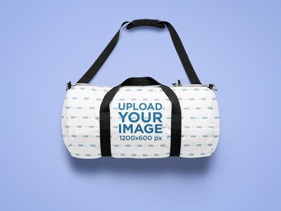 Mockup of a Sublimated Duffle Bag Laid on a Solid Customizable Surface 25524