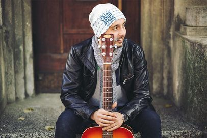 Mockup of a Guitarist Wearing a Beanie on a Cold Day 35144-r-el2