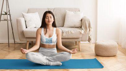 Sports Bra Mockup of a Young Woman Meditating at Home 34537-r-el2