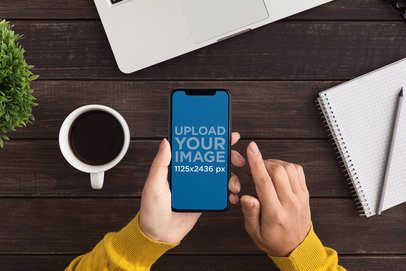 Mockup of a Woman Using an iPhone 11 at Work 36930-r-el2
