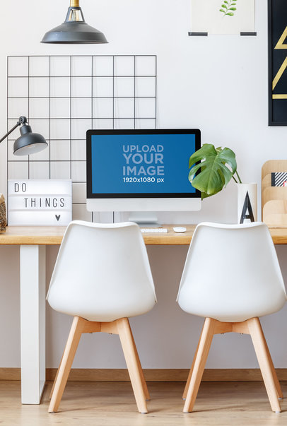 Mockup of an iMac Placed in Front of Two Minimalist Chairs 36937-r-el2