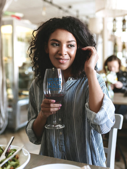 Mockup of a Woman Drinking from a Wine Glass at a Restaurant 36578-r-el2