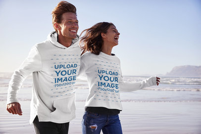 Mockup of a Couple with a Hoodie and a Sweatshirt Running on the Beach 34347-r-el2