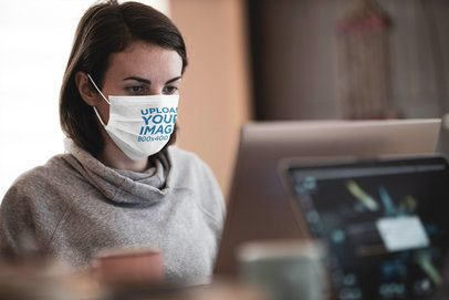 Mockup of a Woman Wearing a Face Mask While Working 4578-el1