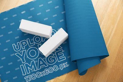 Mockup of a Half-Rolled Yoga Mat over a Wooden Surface 37086-r-el2