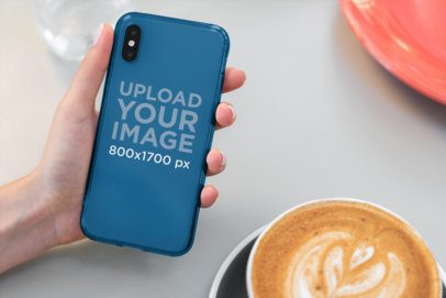 Mockup of Someone Holding a Clear Phone Case at a Cafe 4635-el1