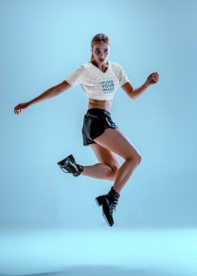 Crop Top Mockup of a Woman Jumping in a Studio 37558-r-el2