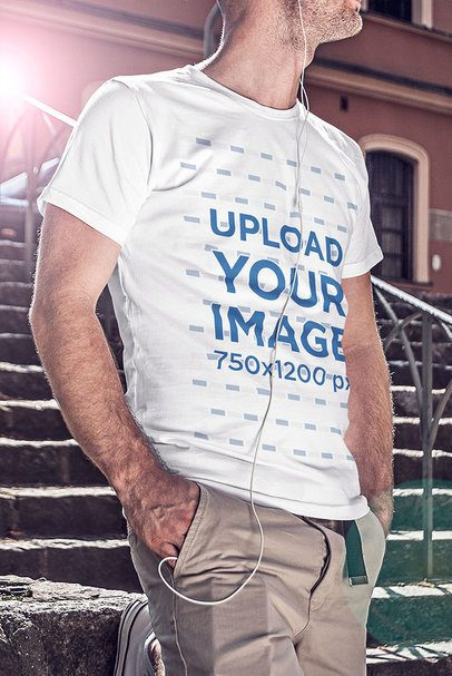 T-Shirt Mockup of a Man Standing by a Stone Staircase 4798-el1