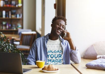 T-Shirt Mockup of a Happy Man Talking on the Phone at a Coffee Store 38104-r-el2